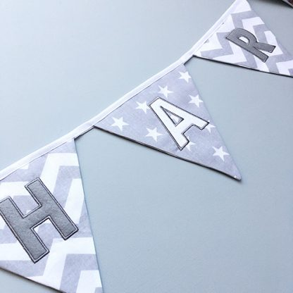 Close up of letters on Grey personalised bunting