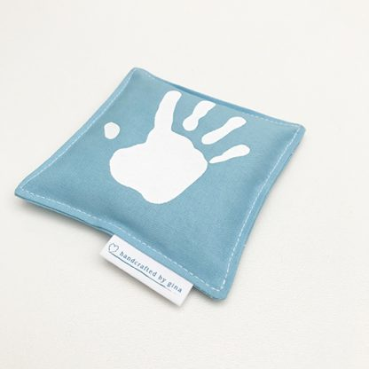 Fabric hand warmers with white screen printed hand print