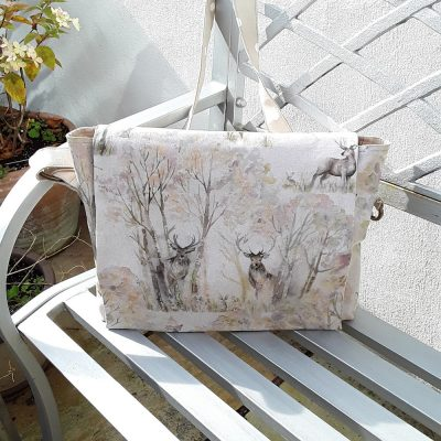 Waterproof messenger bag featuring stags in woodland, adjustable strap.