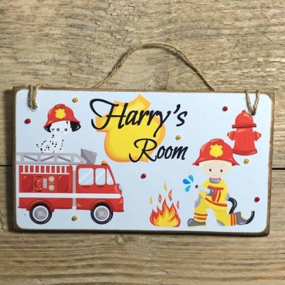 Personalised Fireman Children's Wooden Room Sign on wooden backdrop