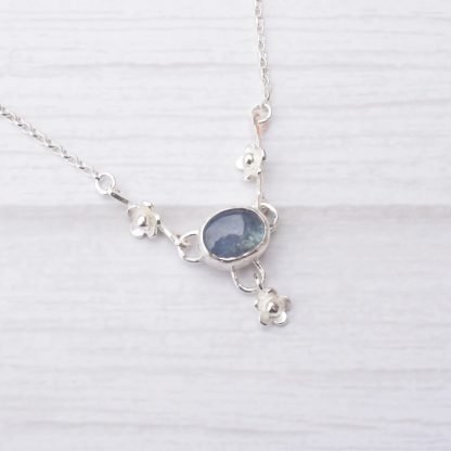 Silver floral necklace with kyanite gemstone by Thistledown Wishes