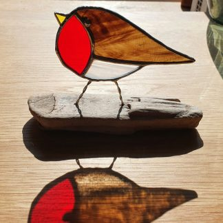 Stained glass driftwood robin with reflection