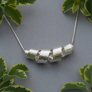 Sterling Silver Corkscrew Curl Twisted Ribbon Pendant Necklace with Parchment texture