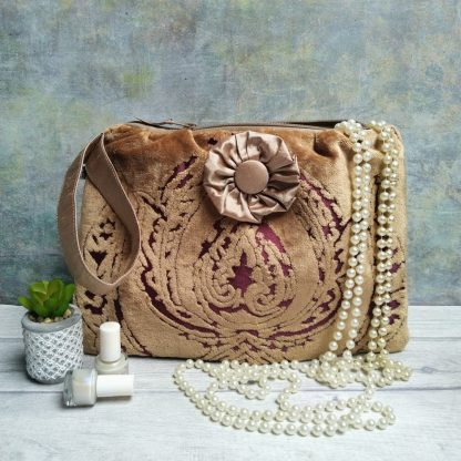Gold and burgundy chenille clutch bag with a silk lining