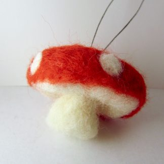 red toadstool christmas bauble