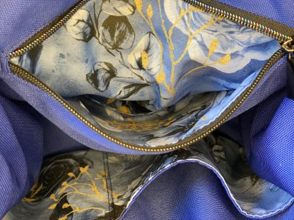 Inner zippered pocket in matching waterproof canvas