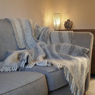 Natural colours striped throw on sofa