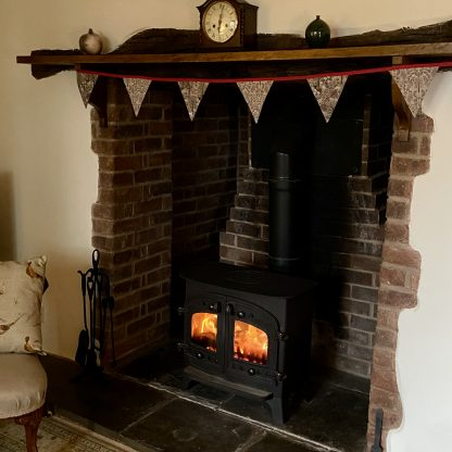 Christmas bunting hung over fireplace. Louise Hancox Textile Artist