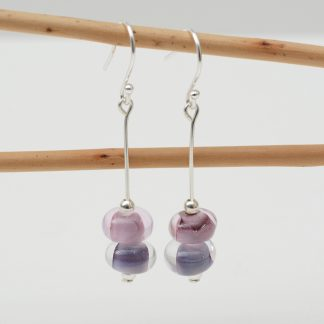 Handmade glass bead earrings in pink and purple with silver findings