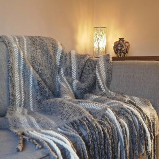 Greu and cream striped throw on sofa