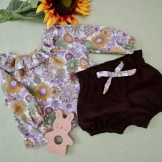 Baby blouse & bloomers. Vintage style sunflower printed fabric make up the long sleeved blouse with frill around the neck. The bloomers have a paper bag style waist & made in brown corduroy
