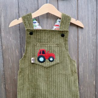 Khaki greens kid's dungarees with a red tractor on the bib pocket