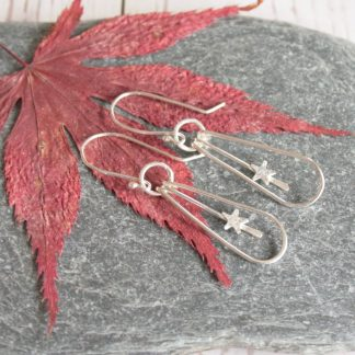 Long silver star earrings by Thistledown Wishes