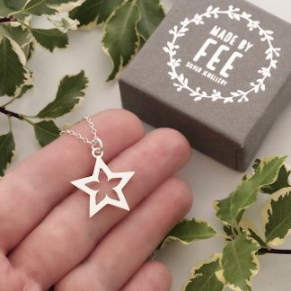 sterling silver star flower pendant necklace on silver cable trace chain