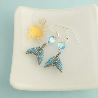 Iridescent blue whale tail dangle earrings