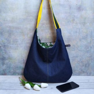 repurposed denim shoulder bag with a green and daisy print lining and green and gold strap