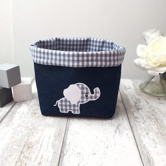 Blue gingham fabric basket with embroidered elephant