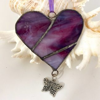 Purple Streaky glass heart with butterfly charm