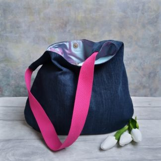 Repurposed dark blue denim hobo bag with a pale blue silk lining and pink shoulder dtrap