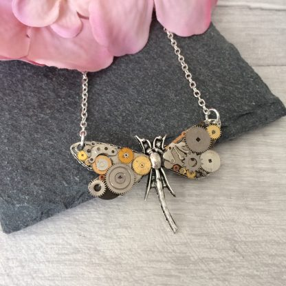Handmade steampunk dragonfly necklace featuring recycled vintage watch parts