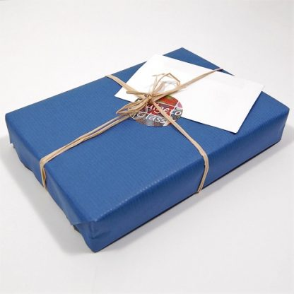 Gift wrapped parcel with a gift tag