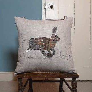 Appliqued running hare cushion
