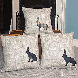Appliqued hare cushion on wool