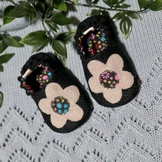 Dark green baby shoes with floral lining