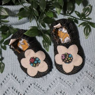 Dark tweed baby shoes with large flower appliqués on the uppers