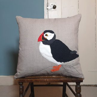 Appliqued puffin on linen cushion