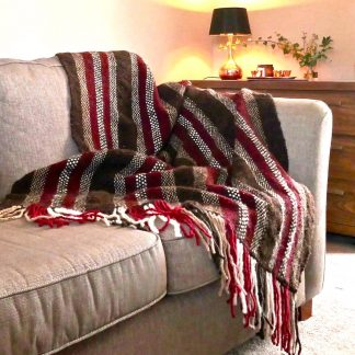 red and brown blanket on sofa