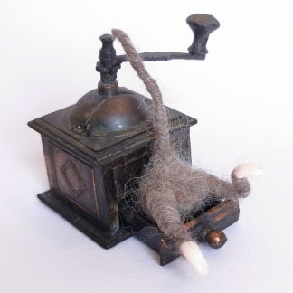 little wool miniature mouse on a vintage coffee grinder