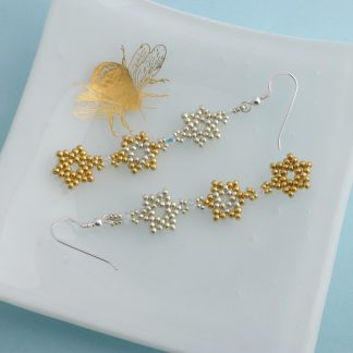 Long earrings with gold and silver stars