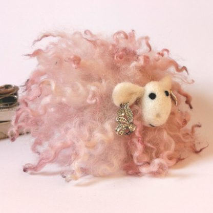 handcrafted pink sheep gift made with curly locks wearing earrings