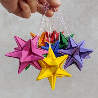 origami star decorations in all the colours of the rainbow