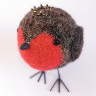 needle felted robin sculpture wearing a crown
