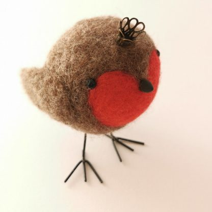Handcrafted christmas robin wool decoration wearing a crown. Sculpted by the needle felting technique using british wool and soft merino for his red breast. C