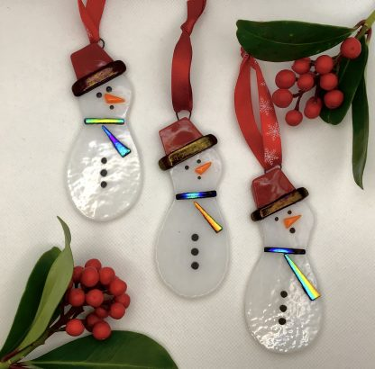 fused glass Snowman with red had and dichroic sparkly scarf
