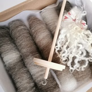 spinning kit with brown wool fibres and a wooden drop spindle