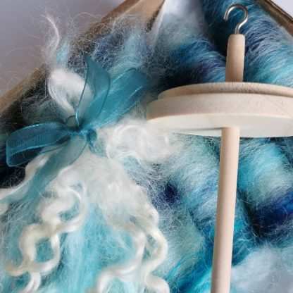 spinning kit with wooden drop spindle and selection of wool