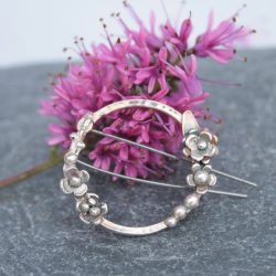 Sterling silver botanical brooch by Thistledown Wishes