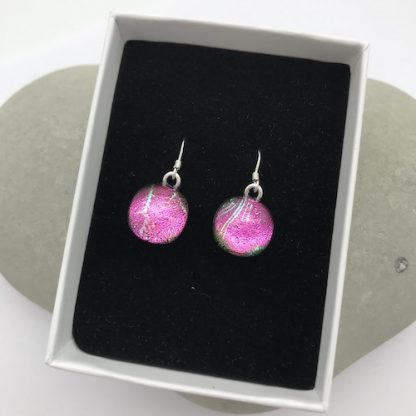 Pink with green feather pattern dangly dichroic glass earrings