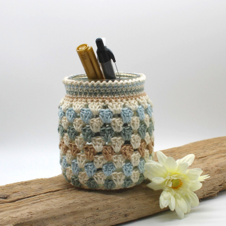 crochet covered jar in coastal colours
