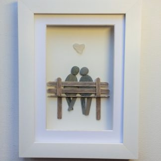pebble art couple on bench