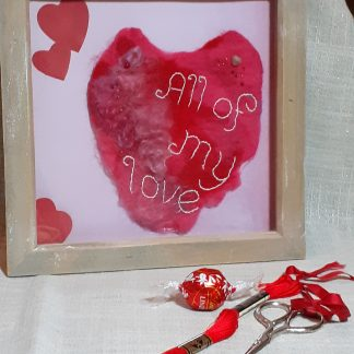Hand felted heart, embellished with stitching and beads.