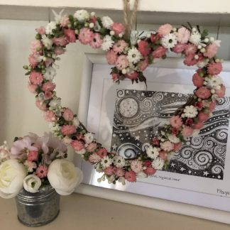 Mini hanging hear decorated with tiny pink and white flowers