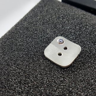 Handmade Tailored Geometric Silver CZ stone Apparel Button is placed on the black foam block.