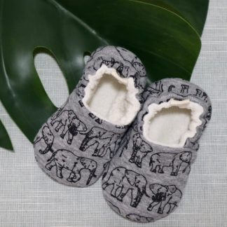 Baby shoes in a grey fabric with elephant print & cream fluffy lining