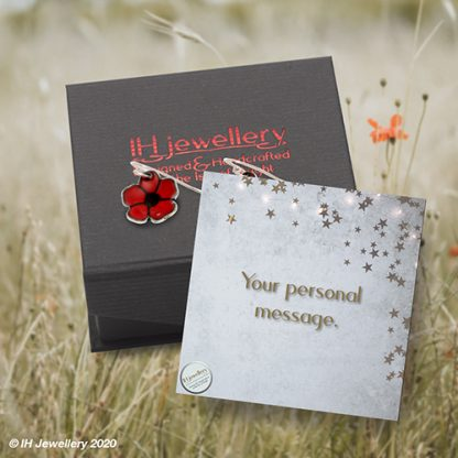 poppy ear drops on branded gift box with personal message card