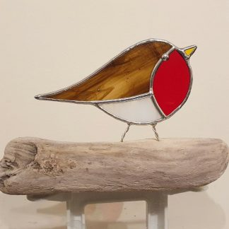 Stained glass robin on driftwood perch